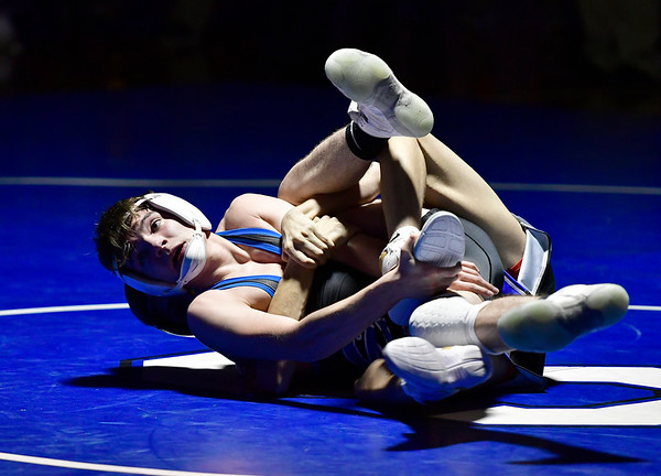 12/12/2018 Mike Orazzi | Staff Bristol Eastern's Riley McCarthy and Southington's Caleb Brick in the 120 match at Southington High School Wednesday night.