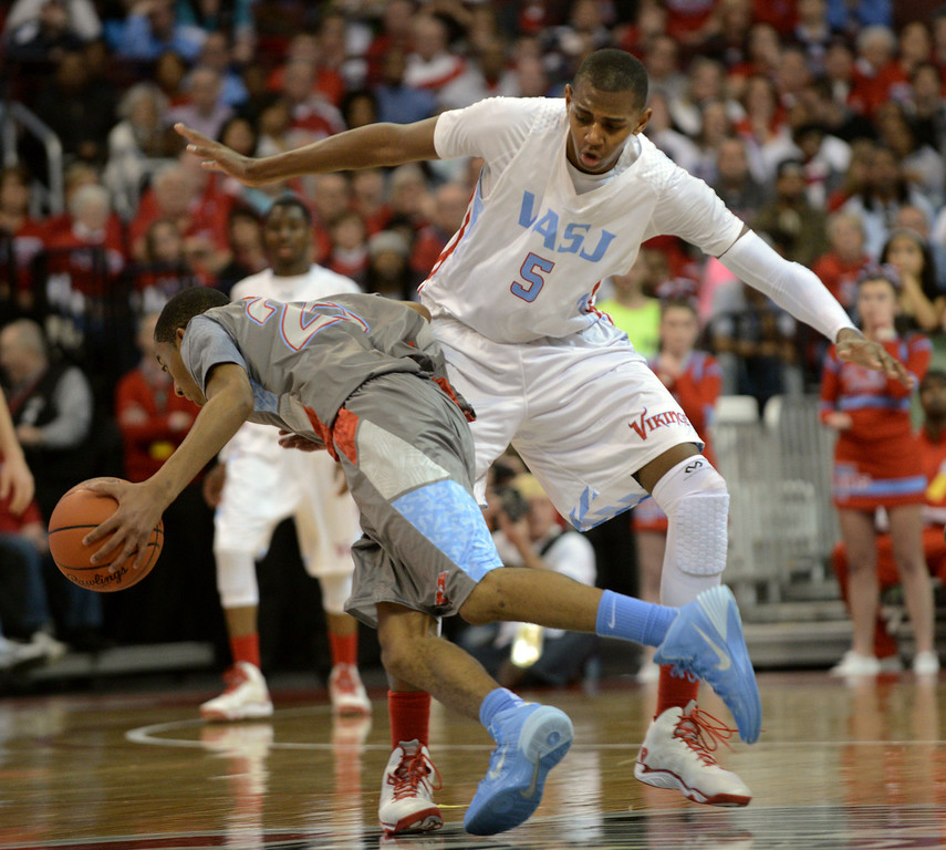 . Duncan Scott/DScott@News-Herald.com VASJ\'s Dererk Pardon blocks the path of Lima Central Catholic\'s Martyce Kimbrough in the second quarter. VASJ\' lost 64-62 in the Division III state championship game on March 22 in the Value City Arena in the  Schottenstein Center in Columbus.