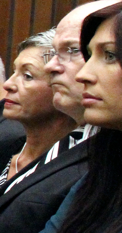 . Alix Tichelman�s sister Monica, right, and her parents Bart and Leslie Tichelman watch stoically on Wednesday as she is arraigned for manslaughter for the 2013 death of Google executive Forrest Hayes. (Shmuel Thaler -- Santa Cruz Sentinel)