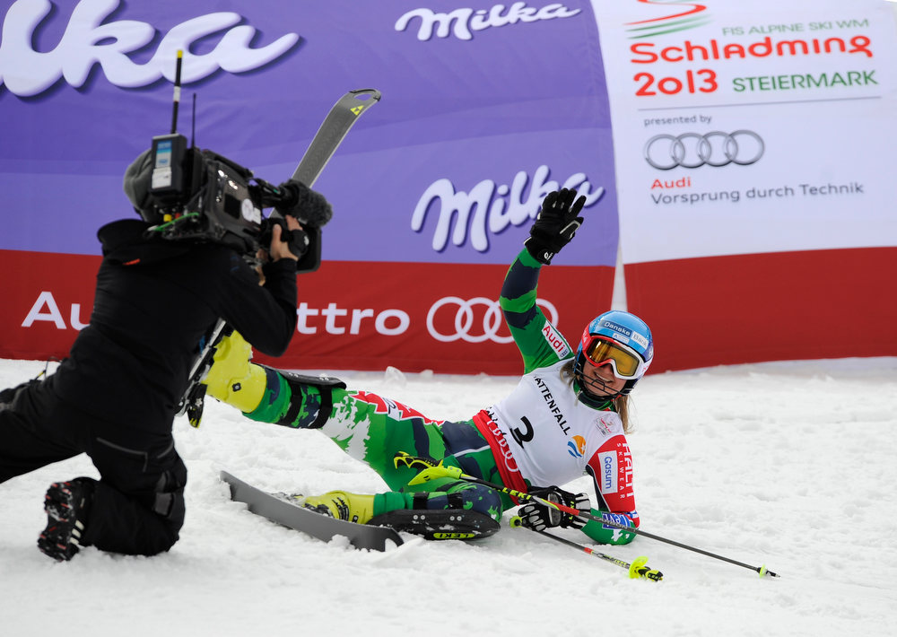 Description of . Finland's Tanja Poutiainen falls as she completes the second run of the women's slalom at the 2013 Ski World Championships in Schladming, Austria on February 16, 2013.  SAMUEL KUBANI/AFP/Getty Images