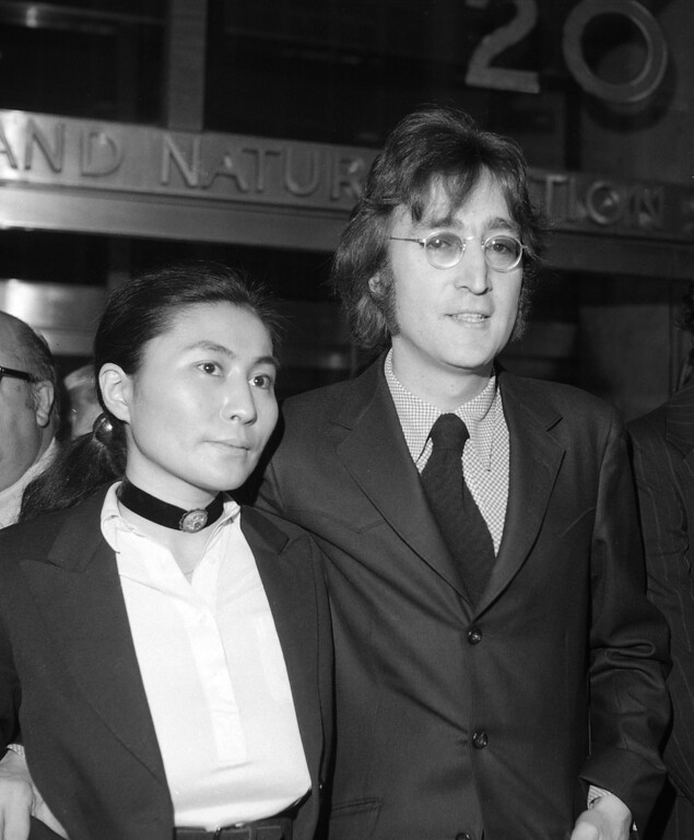 . In this March 16, 1972 file photo, John Lennon and Yoko Ono leave a brief deportation hearing in New York at the offices of the Department of Immigration and Naturalization. Yoko Ono is planning a series of events in Iceland to mark what would have been John Lennon\'s 70th birthday. The artist and peace campaigner will light the Imagine Peace Tower illuminated memorial, located on the island of Vioey near Icelandic capital Reykjavik, on Oct. 9, 2010.  (AP Photo/Tony Camerano, File)
