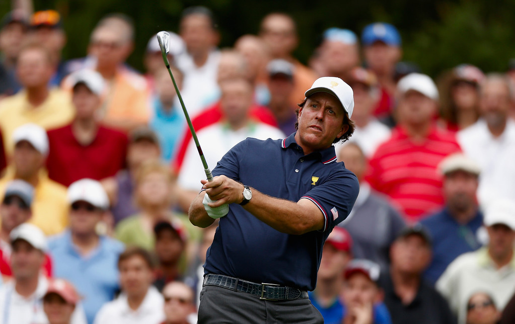 . DUBLIN, OH - OCTOBER 03:  Phil Mickelson of the U.S. Team watches a shot during the Day One Four-Ball Matches at the Muirfield Village Golf Club on October 3, 2013  in Dublin, Ohio.  (Photo by Gregory Shamus/Getty Images)