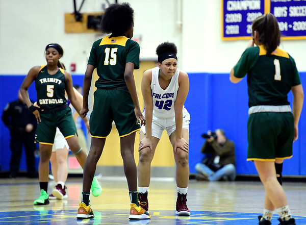 3/8/2019 Mike Orazzi   Staff St. Paul Catholic High School's Jade Udoh (42) and Trinity Catholic's Iyanna Lops (15) during the Class S Semifinal girls basketball game at Newtown High School Friday night in Newtown.