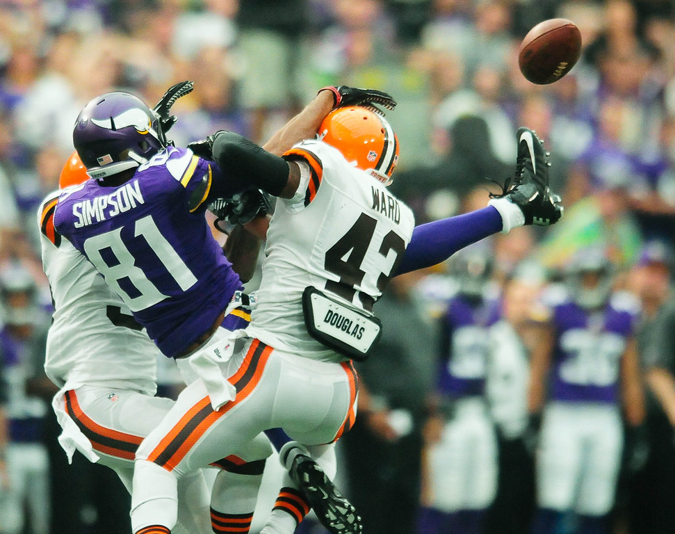 . Vikings wide receiver Jerome Simpson has a pass intended for him broken up by Browns free safety Tashaun Gipson, left, and strong safety T.J. Ward in the second quarter.  (Pioneer Press: Ben Garvin)