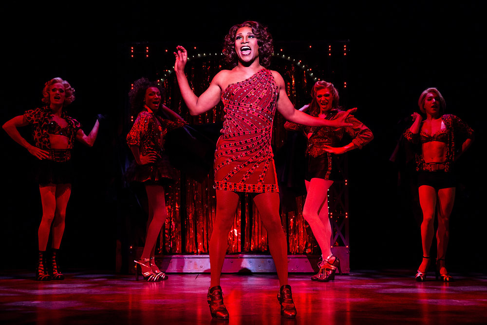 ". This theater image released by The O+M Company shows Billy Porter during a performance of ""Kinky Boots.\"" The Cyndi Lauper-scored \""Kinky Boots,\"" based on the 2005 British movie about a real-life shoe factory that struggles until it finds new life in fetish footwear, is nominated for 13 Tony Award nominations.  The awards will be broadcast on CBS from Radio City Music Hall on June 9. (AP Photo/The O+M Company, Matthew Murphy)"