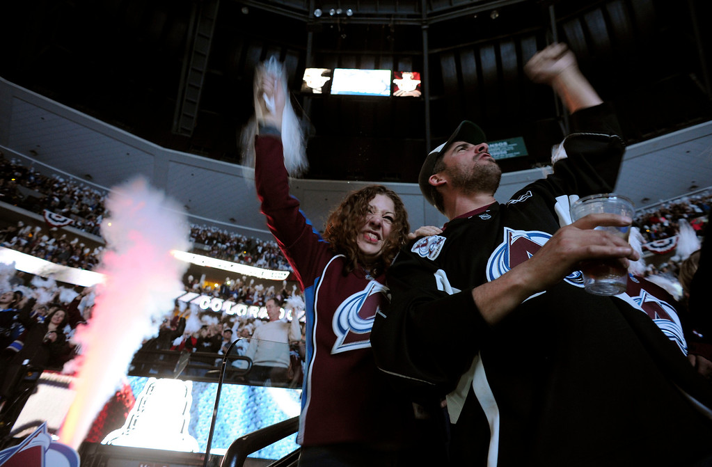 . Avalanche fans Sara Hadlock, age 32, and Brad Amengual, age 38 cheer on the Avalanche prior to the first period of action. The Colorado Avalanche hosted the Minnesota Wild in the first round of the Stanley Cup Playoffs at the Pepsi Center in Denver, Colorado on Saturday, April 19, 2014. (Photo by John Leyba/The Denver Post)