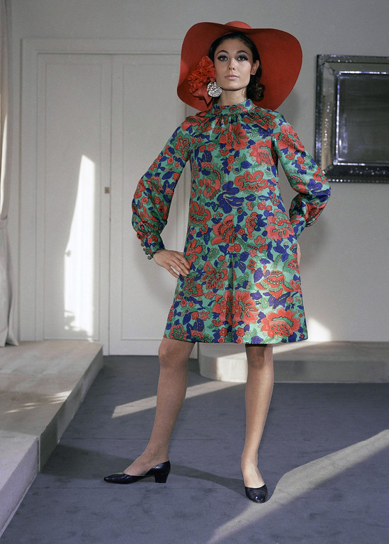 . Dress-culotte in green, red, and blue printed shantung with high neckline gathered into a rolled collar. Poppies and diamonds peep out from under the brim of the undulating red Milan straw hat. Creation by Nina Ricci, Feb. 25, 1967. (AP Photo)