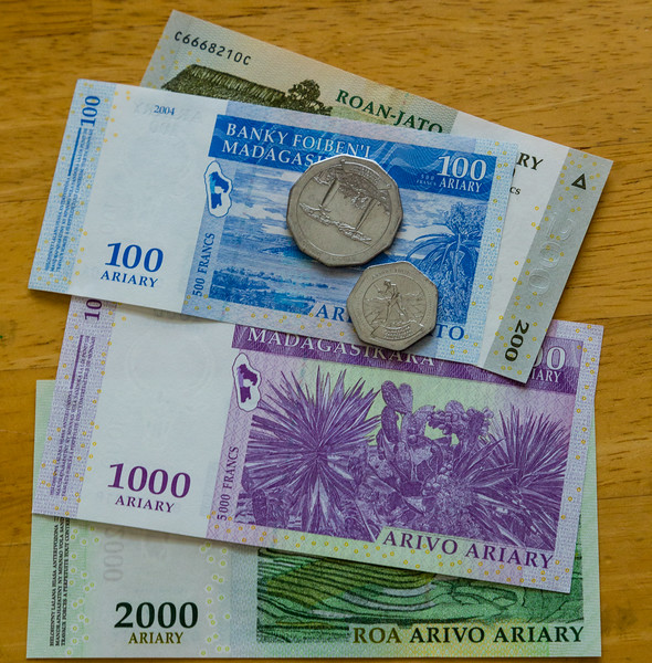 """Some of the currency of Madagascar (called Ariary) that Jenny Mullins brought home after serving the Mercy Ship """"The African Mercy'. Mullins served for 10 months on the hospital ship, which treated just under 1,500 patients for varying ailments. Photo taken on Wednesday, July 13, 2016, in Jenny's home in Royal Palm Beach, Florida. (Joseph Forzano / The Palm Beach Post)"""