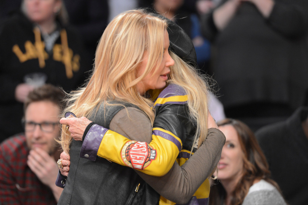 . Jeanie Buss, daughter of Jerry Buss, gets a hug from Dyan Cannon before the start of the Lakers game Wednesday.  Jerry Buss passed away last week.  Photo by David Crane/Staff Photographer