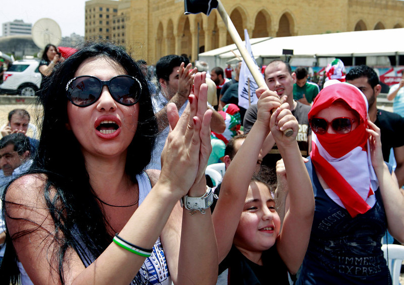 . Lebanese and Syrian activists chant pro-Syrian revolution slogans during a protest against the participation of Hezbollah in the Syrian war, at Martyrs square in Beirut, Lebanon, Sunday, June 9, 2013. A senior Lebanese military official says clashes have erupted outside the Iranian embassy in the capital between protesters opposing Hezbollah\'s participation in the Syrian war and unidentified locals, killing one demonstrator. (AP Photo/Bilal Hussein)
