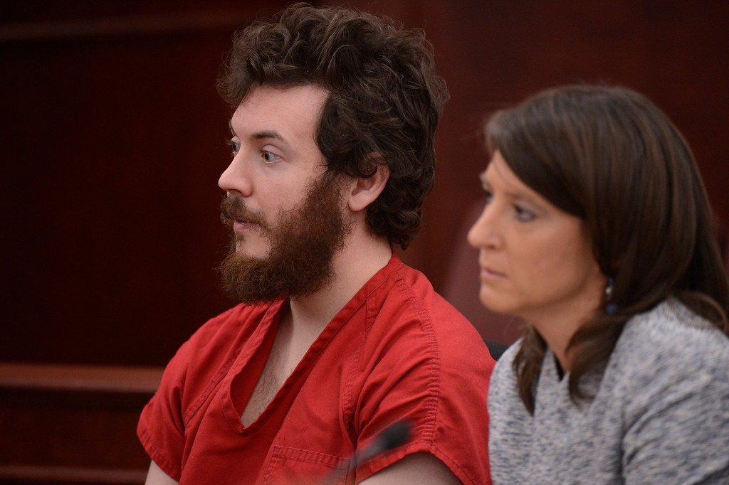 . Aurora theater shooting suspect James Holmes with Defense attorney Tamara Brady in the courtroom during his arraignment Tuesday March 12, 2013. District Court Judge William Sylvester entered a Not Guilty plea on behalf of Holmes. (Photo By RJ Sangosti/The Denver Post)