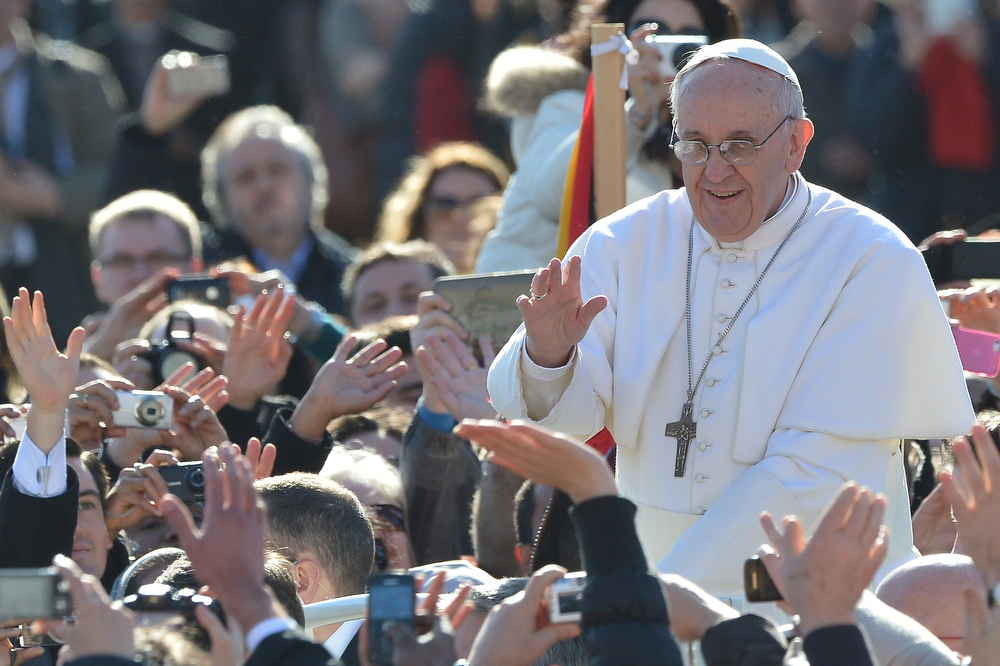 . Pope Francis waves to the crowd from the papamobile during his inauguration mass at St Peter\'s square on March 19, 2013 at the Vatican. World leaders flew in for Pope Francis\'s inauguration mass in St Peter\'s Square on Tuesday where Latin America\'s first pontiff will receive the formal symbols of papal power.  VINCENZO PINTO,VINCENZO PINTO/AFP/Getty Images