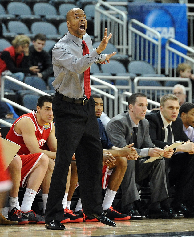 . Metro State head coach Derrick Clark shouts out instructions to his players as they take on Tuskegee during the first half of the NCAA Div. II quarterfinals of the Elite Eight menís basketball tournament at the Ford Center in Evansville, Ind., Wednesday, March 26, 2014.  (AP Photo/The Evansville Courier & Press, Jason Clark)