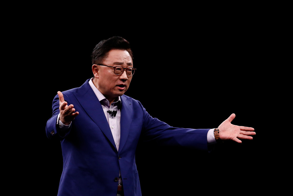 . DJ Koh, Samsung\'s president and head of IT and Mobile Communications Divisions, speaks during a Samsung Galaxy Unpacked 2018 event on the eve of this week\'s Mobile World Congress wireless show, in Barcelona, Spain, Sunday, Feb 25, 2018. Samsung unveiled new smartphones with largely unchanged designs and incremental improvements such as a better camera. (AP Photo/Manu Fernandez)