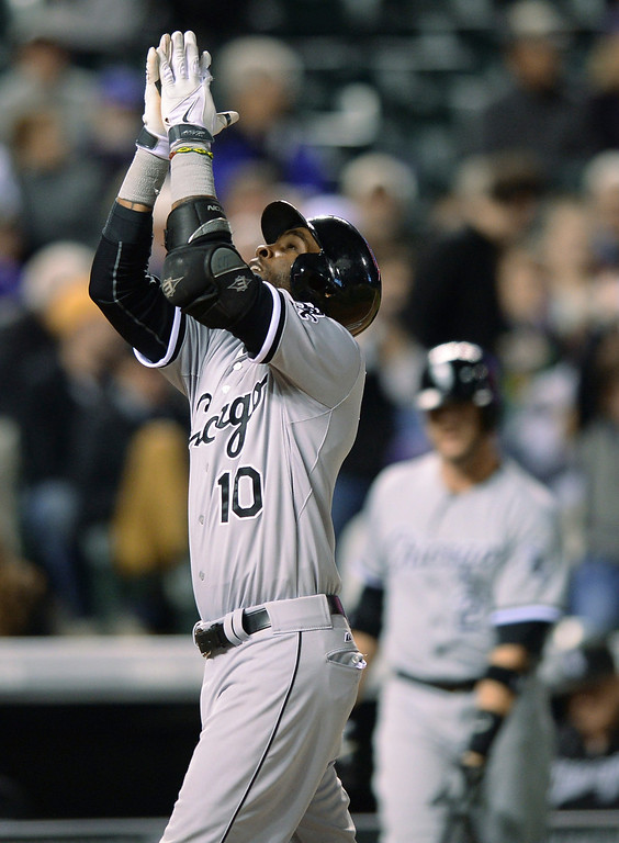 . Chicago baserunner Alexei Ramirez crossed the plate after a Tyler Flowers home run in the eighth inning. The Colorado Rockies hosted the Chicago White Sox Tuesday night, April 8, 2014 at Coors Field in Denver.  (Photo by Karl Gehring/The Denver Post)