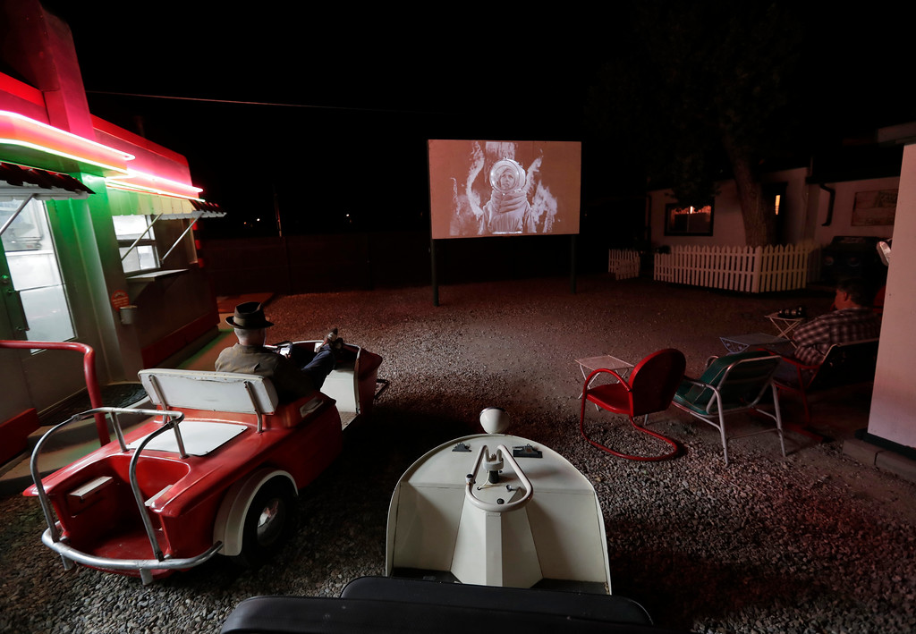""". The 1953 movie \""""Cat Women of the Moon\"""" is shown on the big screen at the Shady Dell Trailer Court, Wednesday, April 26, 2017, in Bisbee, Ariz. Movies and advertisements from the 50\'s are shown nightly on the parks\' big screen adjacent to the snack bar. Vintage golf carts and automobile seats are used from some of the seating. (AP Photo/Matt York)"""