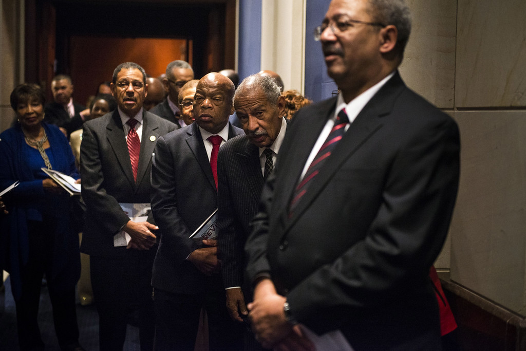 . WASHINGTON, DC - JANUARY 6: Rep. Charles Rangel (D-NY) and Rep. John Lewis (D-GA) along with other members of the Congressional Black Caucus line up before the swearing-in ceremony at the U.S. Capitol on January 6, 2015 in Washington, D.C.  The Congressional Black Caucus Foundation hosts a ceremonial swearing-in event for current and newly-elected members of the 114th Congress.  (Photo by Gabriella Demczuk/Getty Images)