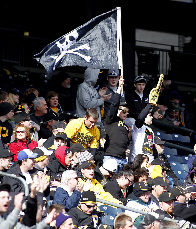 . Pittsburgh Pirates fans cheer during a game against the Chicago Cubs during the opening day game on April 1, 2013 at PNC Park in Pittsburgh, Pennsylvania.  The Cubs defeated the Pirates 3-1.  (Photo by Justin K. Aller/Getty Images)
