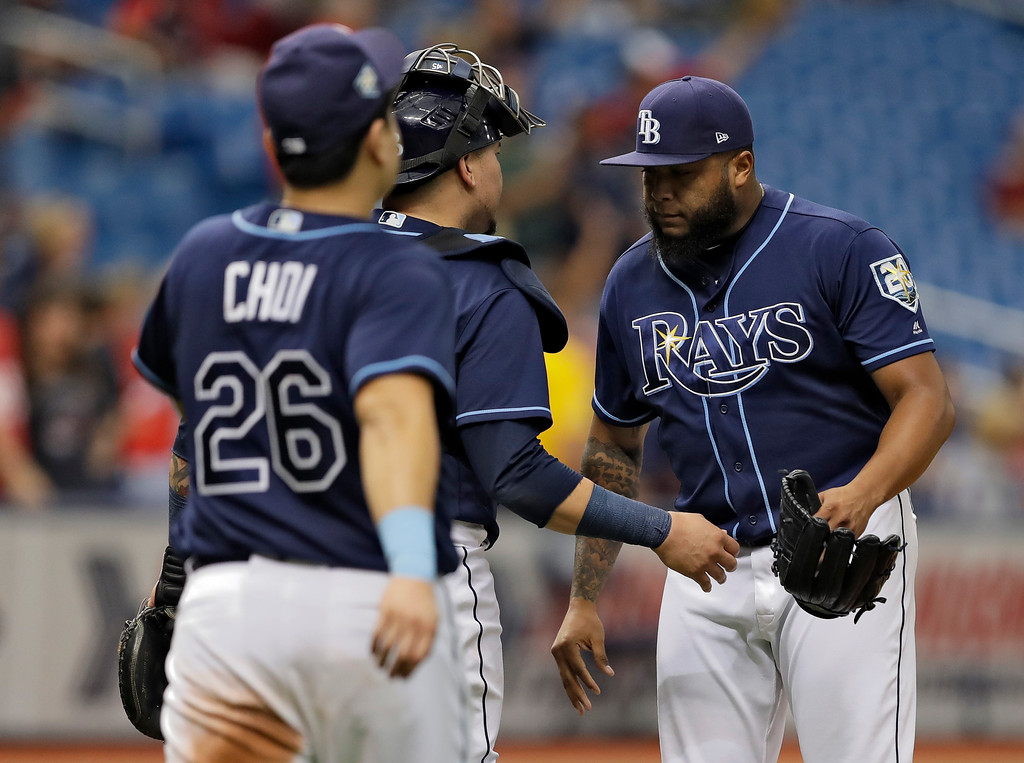 . Tampa Bay Rays pitcher Jose Alvarado, right, celebrates with Jesus Sucre and Ji-Man Choi, of South Korea, right, after the Rays defeated the Cleveland Indians 3-1 during a baseball game Wednesday, Sept. 12, 2018, in St. Petersburg, Fla. (AP Photo/Chris O\'Meara)