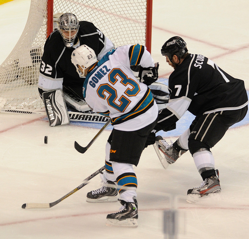 . Kings#32 Jonathan Quick stops a shot by Sharks#23 Scott Gomez in the second period. The Kings played the San Jose Sharks during the first game in the Second Round of the Western Conference Playoffs. Los Angeles CA 5/14/2013(John McCoy/LA Daily News)