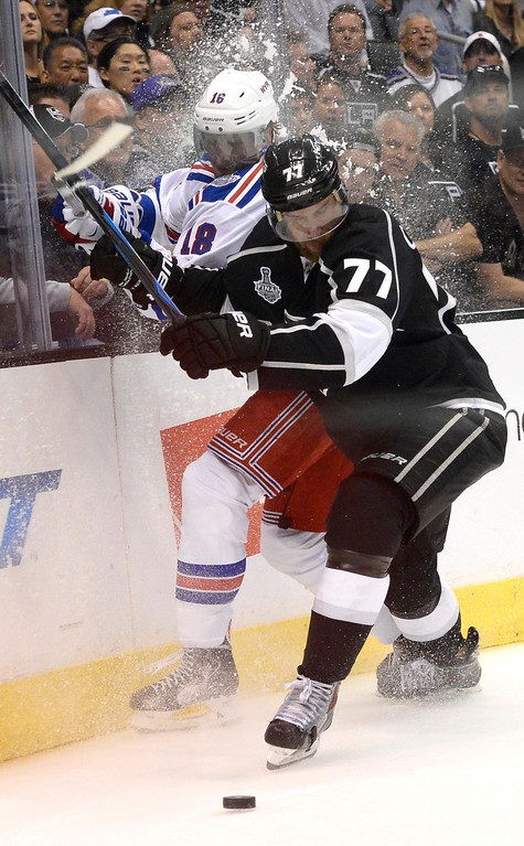 . Rangers Marc Stall is checked into the boards by Kings Jeff Carter in the 3rd period. The Los Angeles Kings faced the New York Rangers in game 1 of the Stanley Cup Finals. Los Angeles, CA. 6/4/2014(Photo by John McCoy / Los Angeles Daily News)
