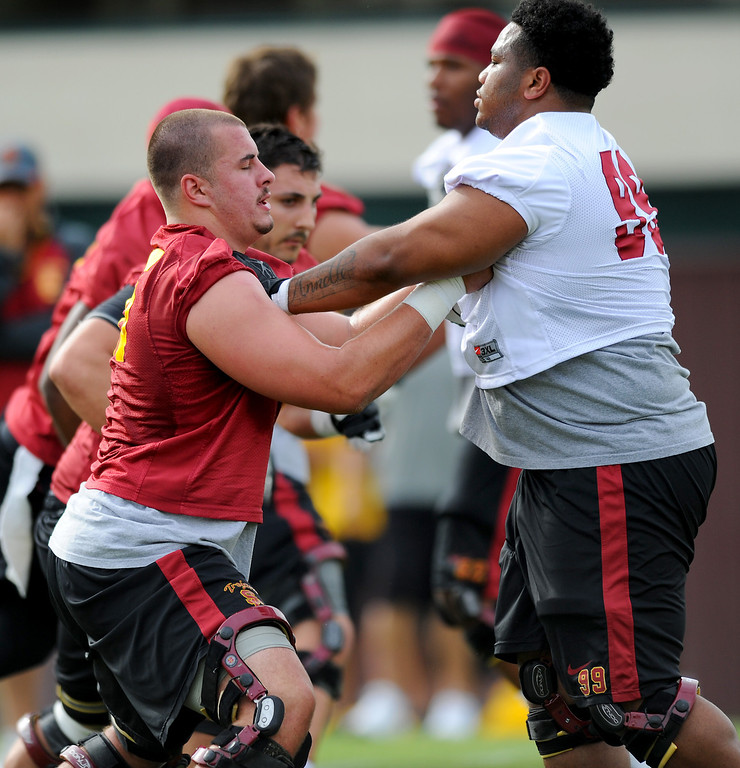 . USC offensive lineman Max Tuerk and nose guard Antwaun Woods face-off at spring practice, Tuesday, March 11, 2014, at USC. (Photo by Michael Owen Baker/L.A. Daily News)