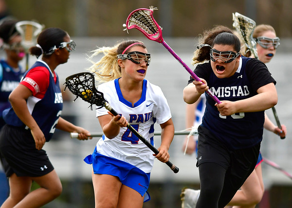 5/2/2019 Mike Orazzi | Staff St. Paul's Isabella Griffin (4) during Thursday's girls lacrosse with Amistad in Bristol.