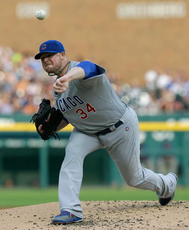 . Chicago Cubs starting pitcher Jon Lester throws during the first inning of a baseball game against the Detroit Tigers, Tuesday, June 9, 2015, in Detroit. (AP Photo/Carlos Osorio)