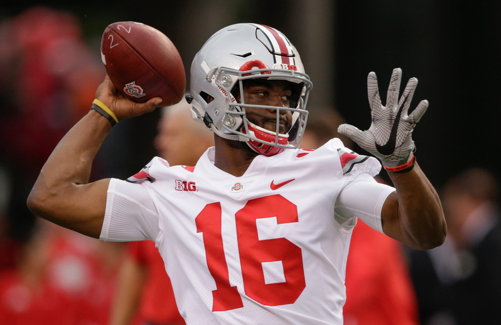 . Ohio State quarterback J.T. Barrett (16) warms up before an NCAA college football game against Nebraska in Lincoln, Neb., Saturday, Oct. 14, 2017. (AP Photo/Nati Harnik)