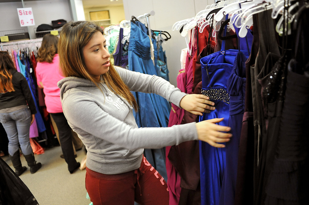 . Laura Lopez looks for the perfect prom dress during Operation School Bell\'s annual Prom Day event at the Assistance League of Los Angeles Thursday March 7, 2013.  Fifty-five homeless or needy LAUSD high school girls were able to select a dress, shoes and accessories during the event.(Andy Holzman/Los Angeles Daily News)