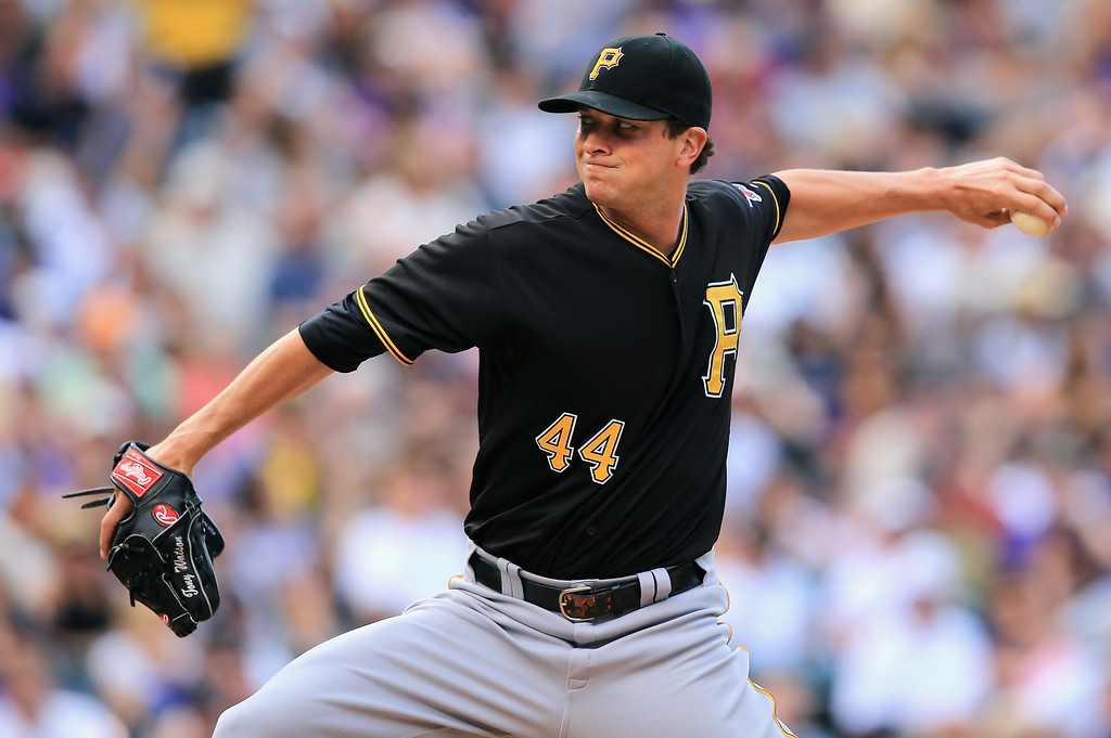 . Relief pitcher Tony Watson #44 of the Pittsburgh Pirates works against the Colorado Rockies at Coors Field on August 11, 2013 in Denver, Colorado. Watson was creditied with a blown save as the Rockies defeated the Pirates 3-2 and swept the three game series.  (Photo by Doug Pensinger/Getty Images)