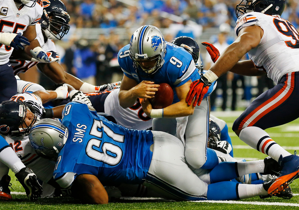 . Detroit Lions quarterback Matthew Stafford (9) falls over the goal line for a touchdown after recovering his own fumble during the second quarter of an NFL football game against the Chicago Bears at Ford Field in Detroit, Sunday, Sept. 29, 2013. (AP Photo/Paul Sancya)