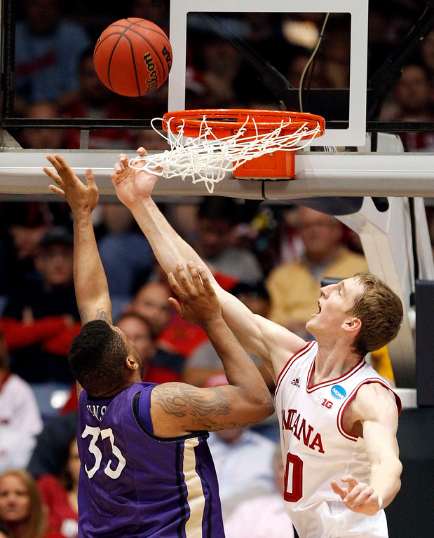 . Indiana Hoosiers forward Cody Zeller (R) blocks a shot by James Madison Dukes forward Rayshawn Goins (33) during the first half of their second round NCAA tournament basketball game in Dayton, Ohio March 22, 2013. REUTERS/Matt Sullivan