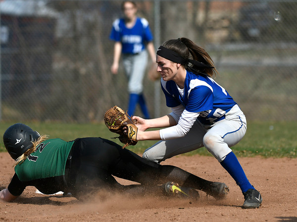 4/13/2018 Mike Orazzi | Staff Bristol Eastern's Jordan Fitzsimons (10) and Enfield's Taylor Fritz (10) during Friday's softball with Enfield in Bristol.