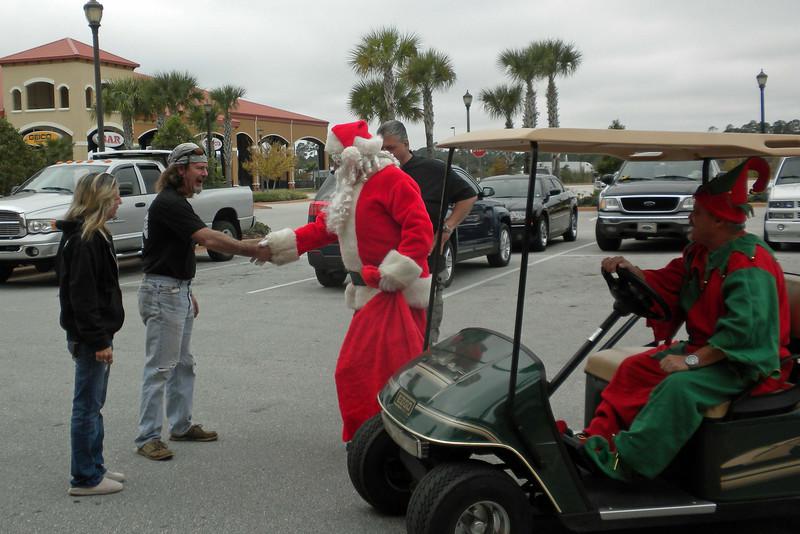 007 Santa arriving at J&P Cycles.jpg