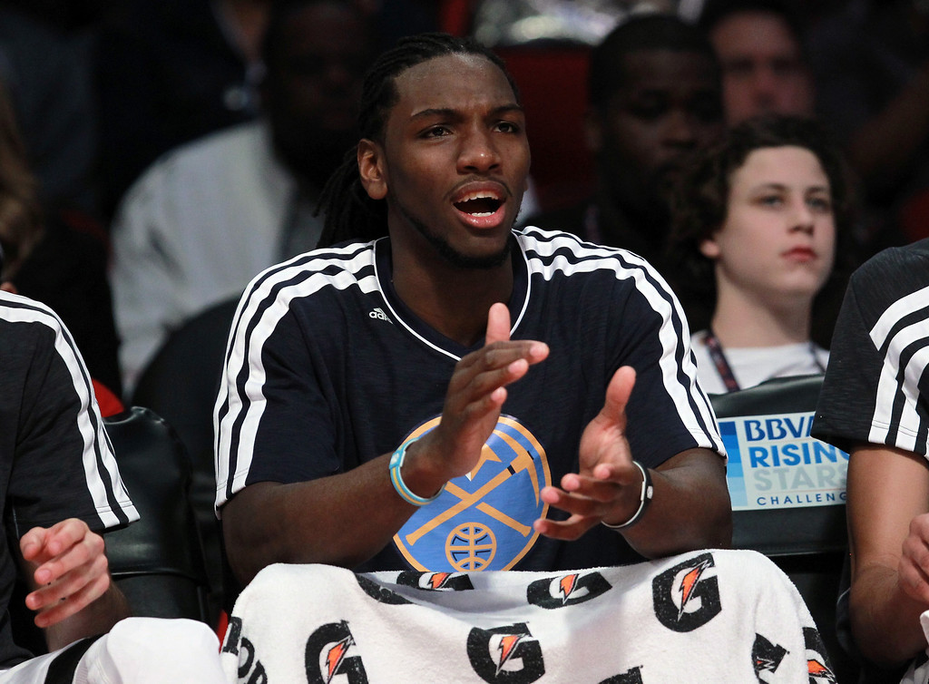 . HOUSTON, TX - FEBRUARY 15:  Kenneth Faried #35 of the Denver Nuggets and Team Chuck reacts from the bench in the second half in the BBVA Rising Stars Challenge 2013 part of the 2013 NBA All-Star Weekend at the Toyota Center on February 15, 2013 in Houston, Texas.  (Photo by Ronald Martinez/Getty Images)