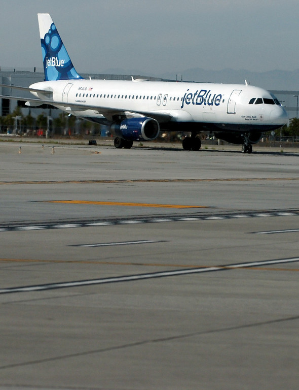 . A jetBlue plane taxi\'s in at the Long Beach Airport August 6, 2013. (Thomas R. Cordova/Staff Photographer)