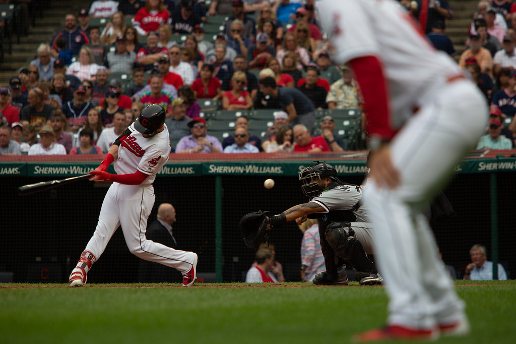 . Tyler Naquin of the Cleveland Indians swings at a pitch during a regular season game against the Chicago White Sox at Progressive Field on June 20, 2018. (The Morning Journal/Michael Johnson)