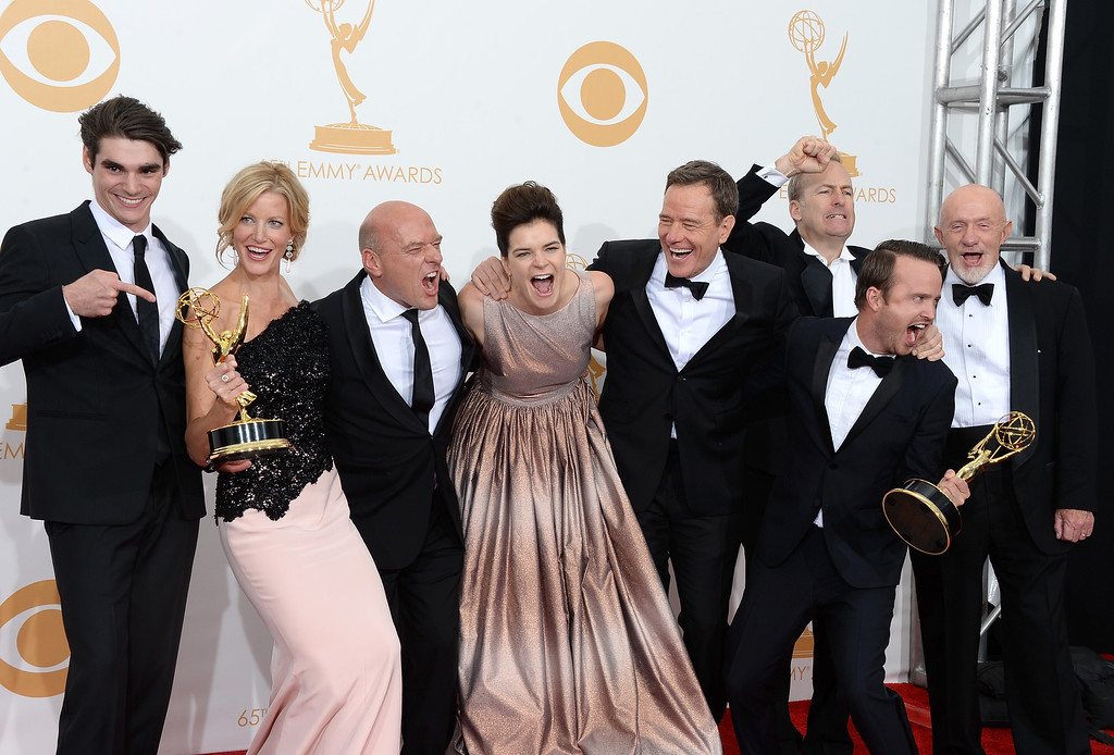 ". (L-R) Actors RJ Mitte, Anna Gunn, Dean Norris, Betsy Brandt, Bryan Cranston, Aaron Paul, Bob Odenkirk and Jonathan Banks, winners of the Best Drama Series Award for ""Breaking Bad,\"" pose in the press room during the 65th Annual Primetime Emmy Awards held at Nokia Theatre L.A. Live on September 22, 2013 in Los Angeles, California.  (Photo by Jason Merritt/Getty Images)"