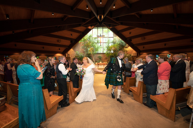 Coming down the aisle greeting Guests.jpg