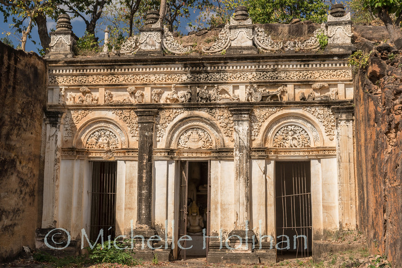 Shrine carved from solid sandstone at Po Win Taung Cave Temples wtih colonial era decoration in Monywa, Myanmar