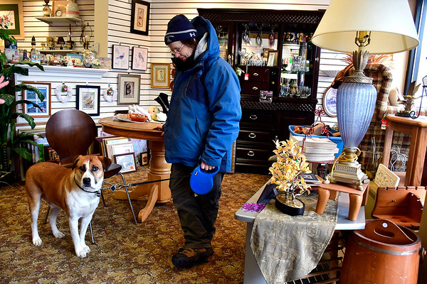 2/5/2020 Mike Orazzi | Staff Donna Vincent and her dog Moses at the Hand to Hand Direct Care Ministry on North Main Street in Bristol.