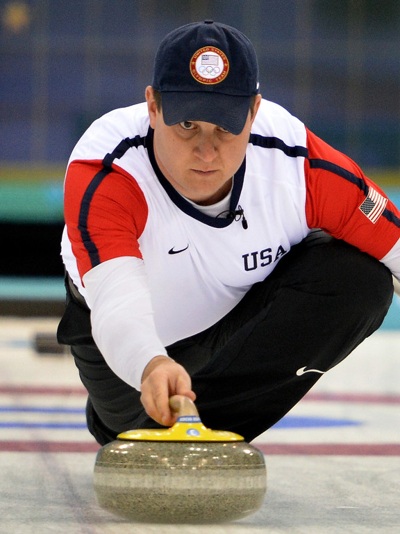 . US curler John Shuster throws the stone during the 2014 Sochi Winter Olympics Men\'s Curling Round Robin Session 12 match against Switzerland at the Ice Cube Curling Centre in Sochi on February 17, 2014.   YURI KADOBNOV/AFP/Getty Images