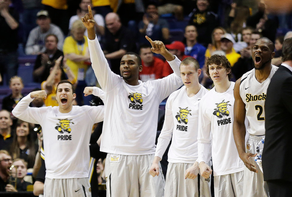 . Wichita State celebrates against Cal Poly during the first half of a second-round game in the NCAA college basketball tournament Friday, March 21, 2014, in St. Louis. (AP Photo/Charlie Riedel)