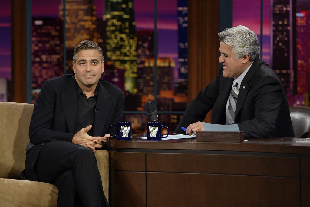 ". George Clooney is shown during a taping of  ""The Tonight Show with Jay Leno,\"" Thursday, Oct. 6, 2005, in Burbank, Calif., to promote the film \""Good Night, and Good Luck.\""  Clooney directs and co-stars in the story of newsman Edward R. Murrow (David Strathairn) as he battles the communist witch hunt. (AP Photo/NBC, Paul Drinkwater)"