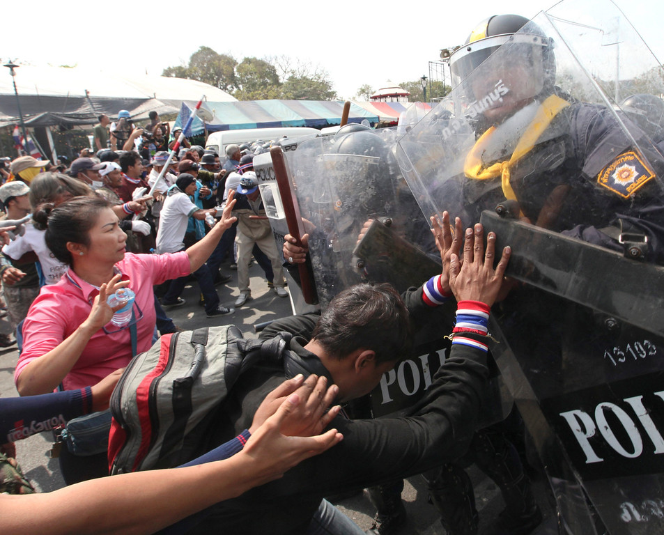 . Thai anti-government protesters push against riot policemen during clashes at a protest site near Democracy Monument in Bangkok, Thailand, 18 February 2014.   EPA/PETER CHAN