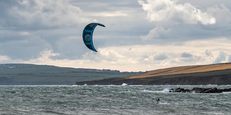 Man parasailing off the beach, Garrylucas Beach, Kinsale, County Cork, Ireland