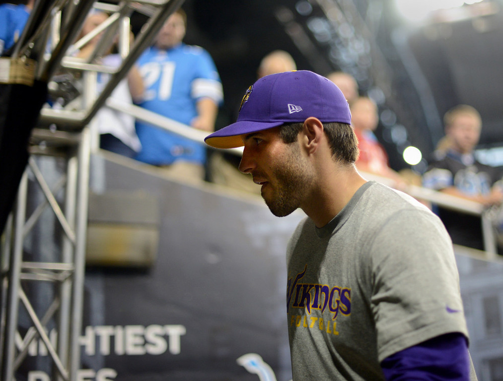 . Vikings quarterback Christian Ponder walks off the field after a pre-game warm-up at Ford Field.  (Pioneer Press: Chris Polydoroff)