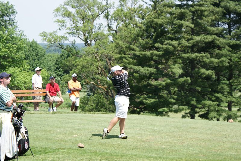 Rob Chappell hits his tee shot to the par 3 16th.