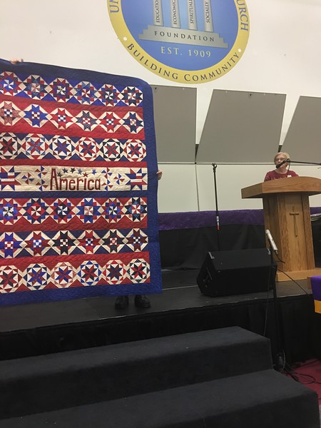 Marcia Rosenburger created this quilt from a photograph as she did not have a pattern.  Being donated to Quilts of Valor and was machine quilted by Mary Hausauer.